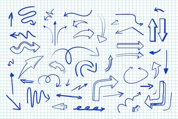 Collezione di frecce disegnate a mano Vettore gratuito
