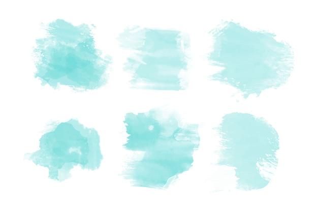 Collezione di macchie di acquerello blu Vettore gratuito
