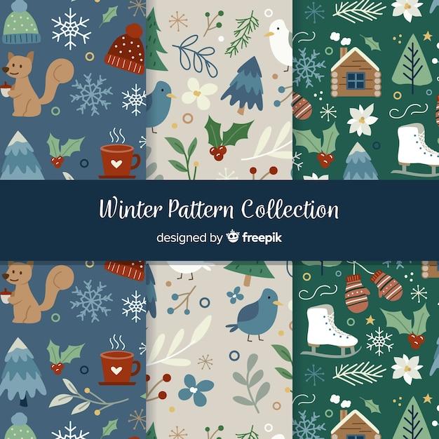 Collezione di modelli invernali disegnata a mano Vettore gratuito
