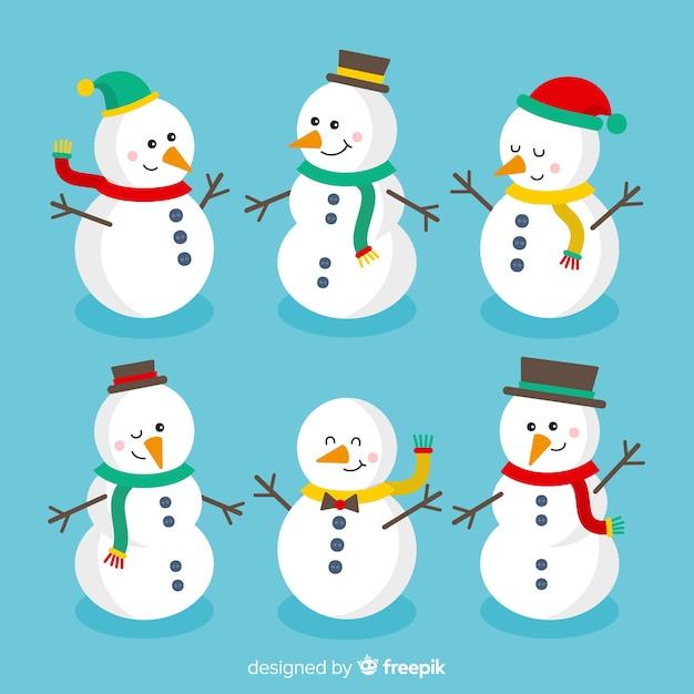 Collezione di simpatici pupazzi di neve in design piatto Vettore gratuito