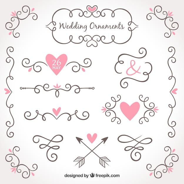 Collezione disegnata a mano di ornamenti di nozze Vettore gratuito