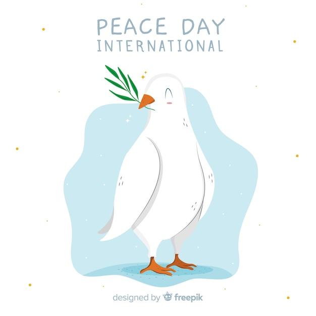 Colomba bianca di giorno di pace disegnata a mano Vettore gratuito