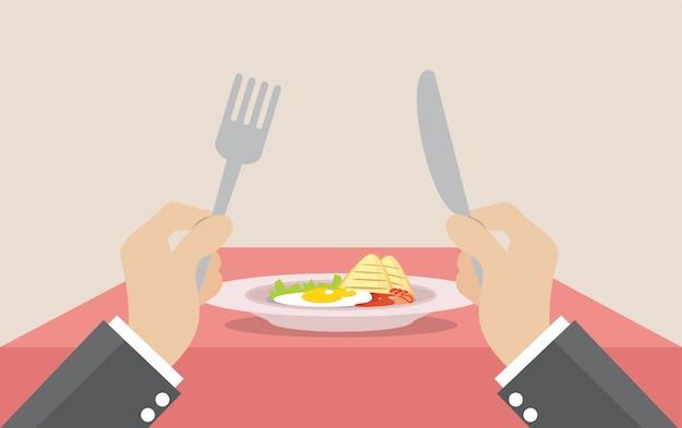 Coltello e forcella della tenuta dell'uomo d'affari per mangiare prima colazione nel piatto. Vettore Premium