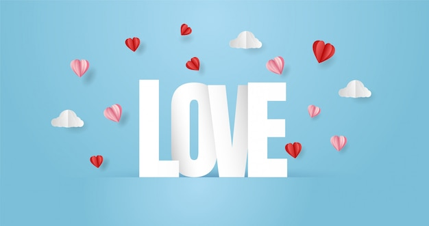 Composizione con scritta love e taglio origami a cuore di carta Vettore Premium