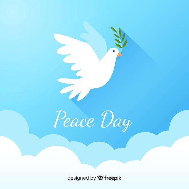 Composizione del giorno della pace con piatta colomba bianca Vettore gratuito