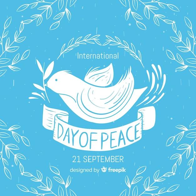 Composizione di giorno di pace con colomba bianca disegnata a mano Vettore gratuito
