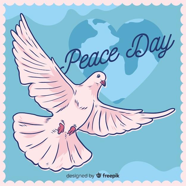 Composizione di giorno di pace con la colomba bianca disegnata a mano Vettore gratuito