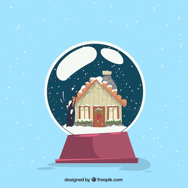 concetto di natale con la casa in palla di vetro