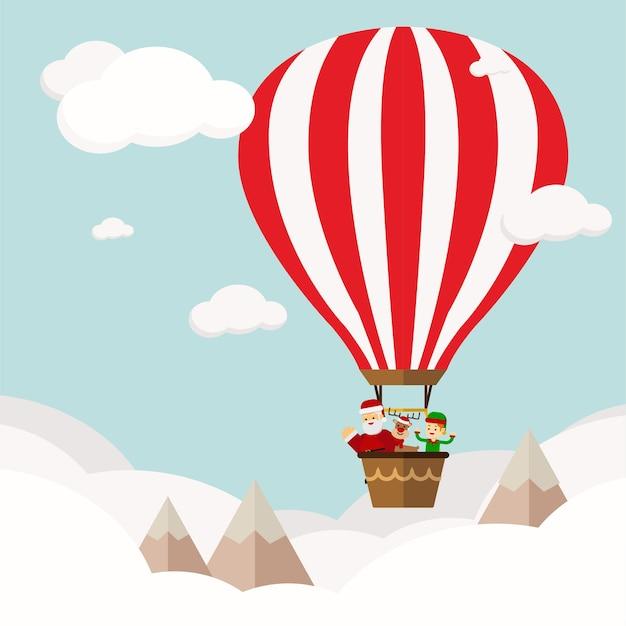 Concetto di natale funny new year's company in hot air ballon Vettore Premium