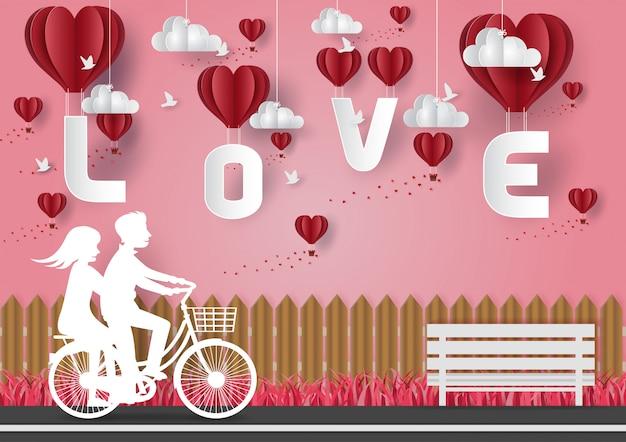 Concetto di san valentino. uomini e donne che vanno in bicicletta in strada. carta vettoriale Vettore Premium