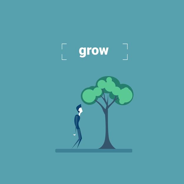 Concetto di sviluppo di crescita di investimento dell'albero di standing under green dell'uomo d'affari Vettore Premium