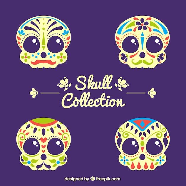 Confezione da teschi colorati ornamentali Vettore gratuito