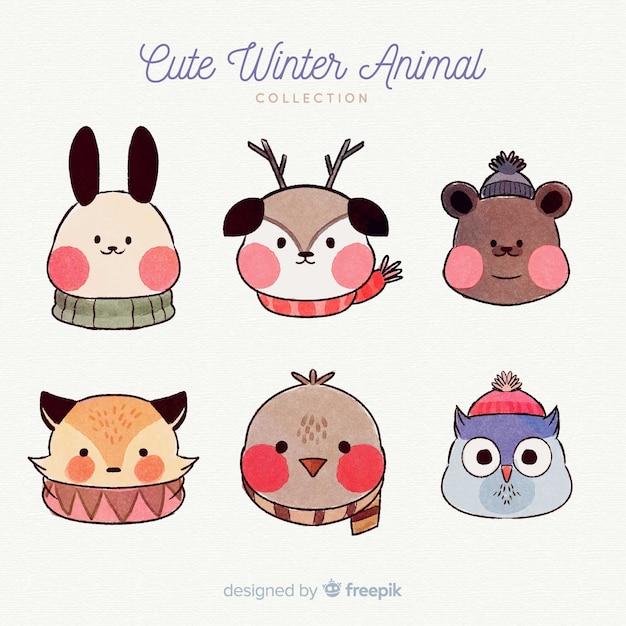 Confezione di animali invernali disegnata a mano Vettore gratuito