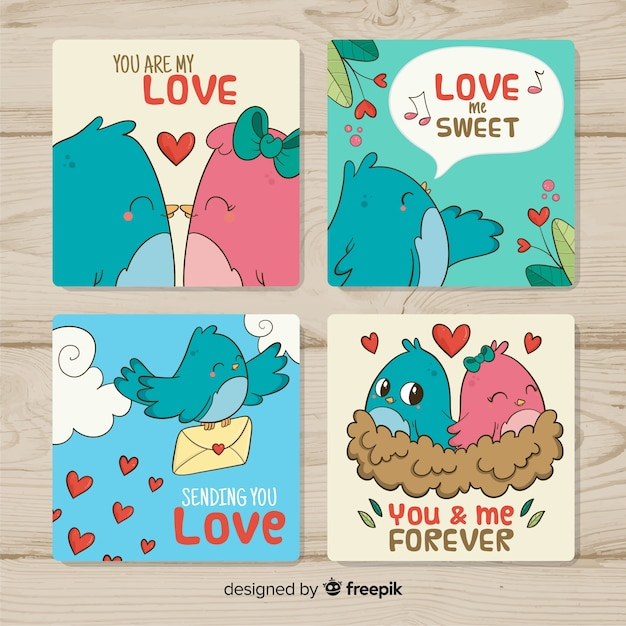 Confezione di carte di san valentino uccelli disegnati a mano Vettore gratuito