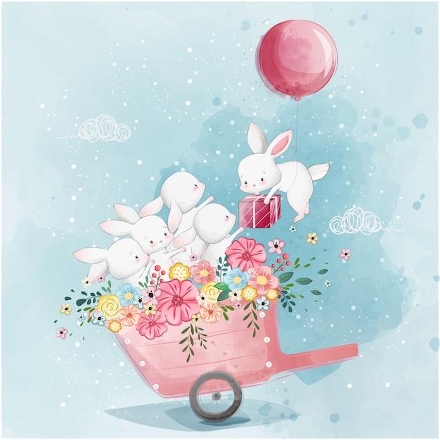 Coniglietti carini nel carrello di primavera Vettore Premium