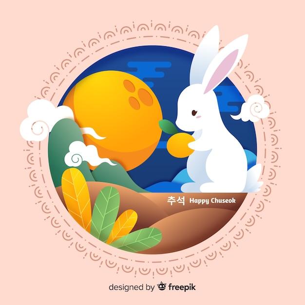 Coniglietto design piatto che tiene arancia Vettore gratuito