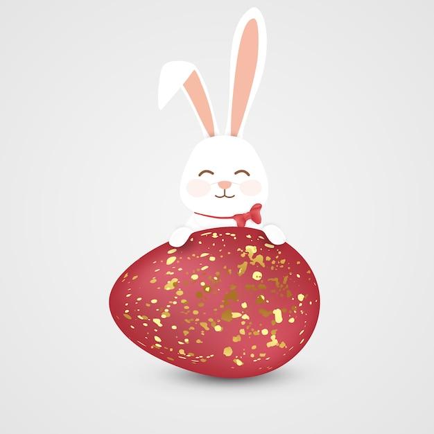Coniglietto di buona pasqua con uovo rosso Vettore Premium