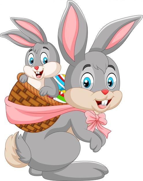 Coniglietto di pasqua che trasportano cesto di coniglio bambino Vettore Premium