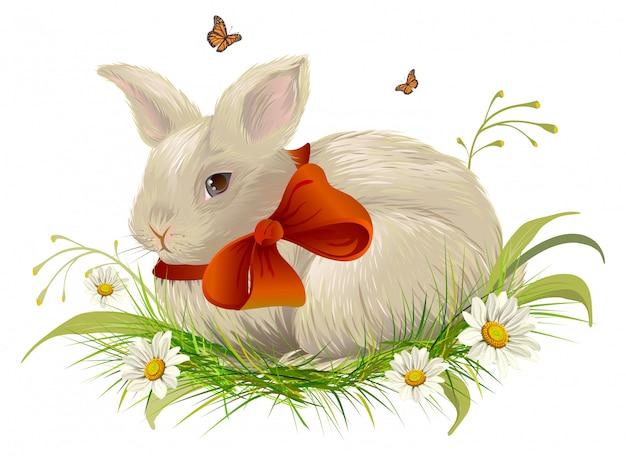 Coniglio carino con fiocco seduto sull'erba. coniglio di pasqua con nastro rosso Vettore Premium