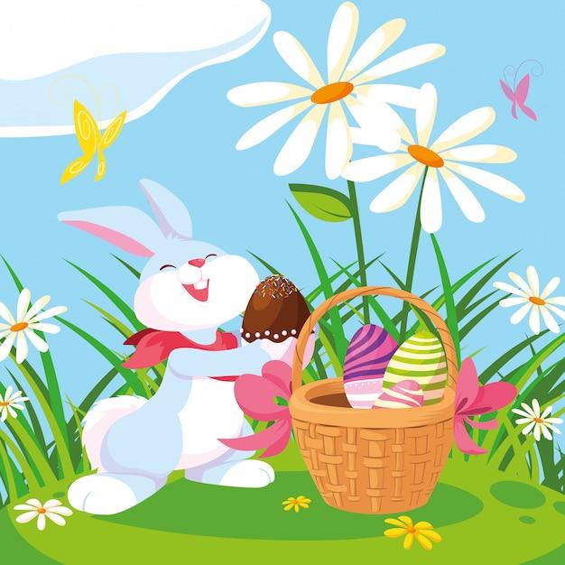 Coniglio con le uova di pasqua con il cestino in giardino Vettore Premium