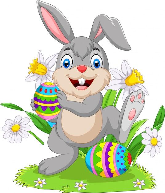 Coniglio di pasqua con uova decorate Vettore Premium
