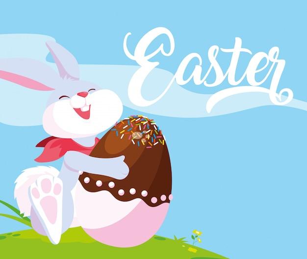 Coniglio e uovo di pasqua decorati con caramelle Vettore Premium
