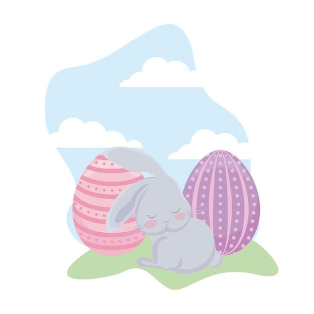 Coniglio sveglio con le uova di pasqua in erba Vettore Premium