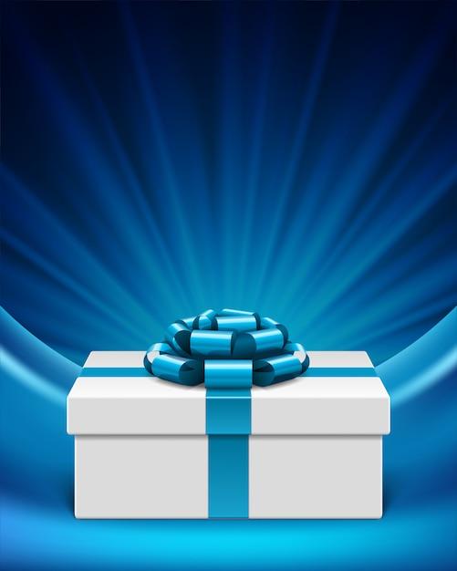 Contenitore di regalo bianco con il nastro blu dell'arco con i raggi e l'illustrazione della stella delle luci Vettore Premium