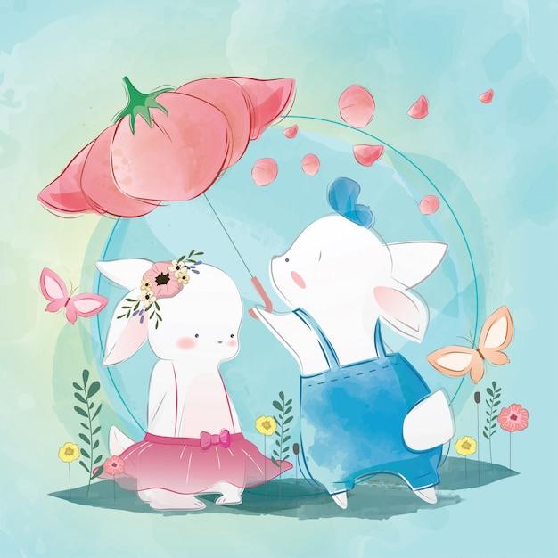 Coppia bunny under flower umbrella Vettore Premium