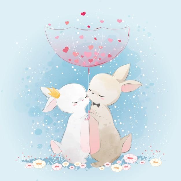Coppia bunny under love rain Vettore Premium