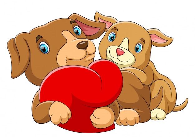 Coppia cane innamorato di un cuore rosso Vettore Premium