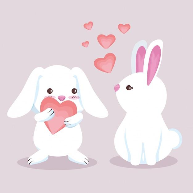 Coppia di coniglio carino con cuori adorabili Vettore gratuito