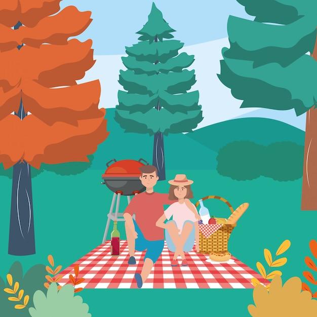 Coppia di donna e uomo che hanno picnic Vettore Premium