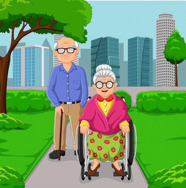 Coppie anziane del fumetto nel parco Vettore Premium