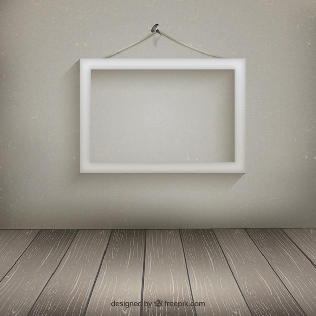 Cornice bianca appesa al muro scaricare vettori gratis for Cornice bianca foto