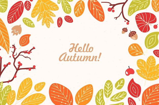 Cornice di carta o bordo fatto di foglie secche cadute, ghiande, coni, bacche e frase ciao autunno scritta con carattere calligrafico corsivo. Vettore Premium