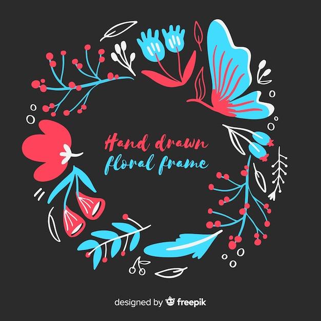 Cornice floreale disegnata a mano Vettore gratuito