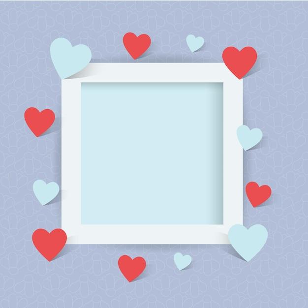 Cornice foto con il segno del cuore Vettore Premium