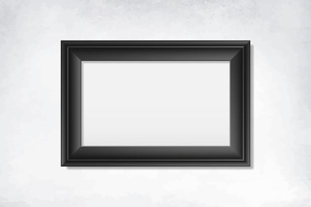 Cornice nera vuota sul muro Vettore gratuito