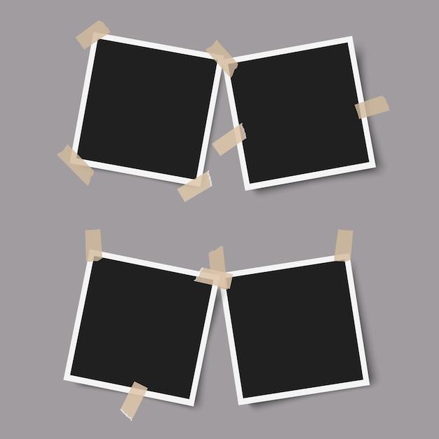 Cornici per foto realistiche con ombre con nastro adesivo su grigio Vettore Premium