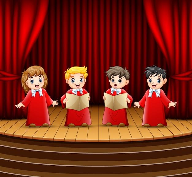Coro di bambini che si esibiscono sul palco Vettore Premium
