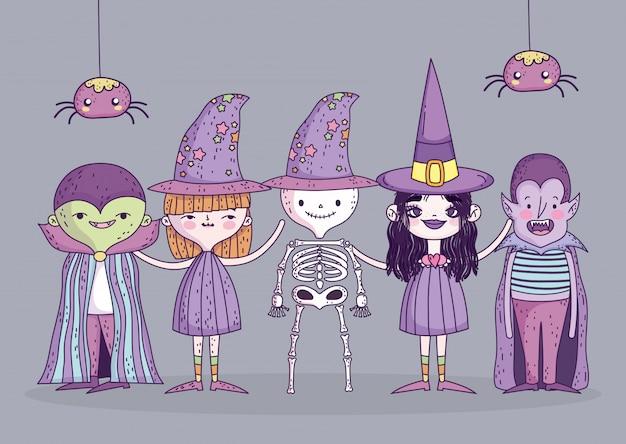 Costumi di ragazze e ragazzo felice celebrazione di halloween e ragni Vettore Premium