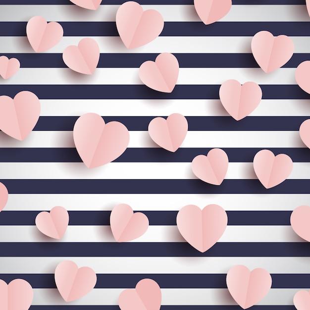 Cuori rosa su uno sfondo a strisce Vettore gratuito