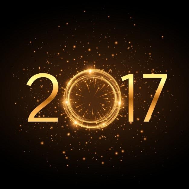 d'oro 2017 anno nuovo testo con effetto glitter incandescente e fuochi d'artificio Vettore gratuito