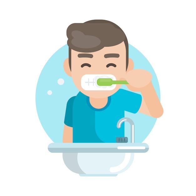 Denti di spazzolatura del ragazzo sveglio felice in bagno Vettore Premium