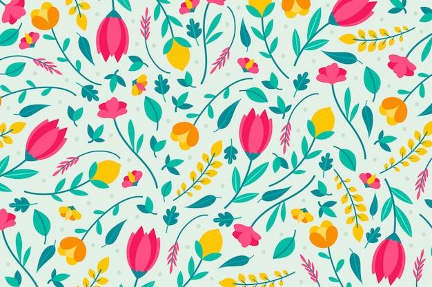 Design colorato per la carta da parati con stampa floreale Vettore gratuito
