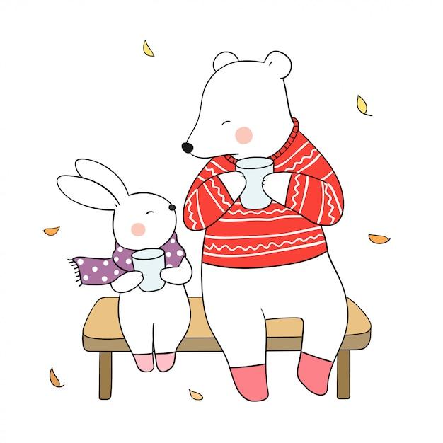 Disegna l'orso e il coniglio a bere il tè caldo in autunno. Vettore Premium