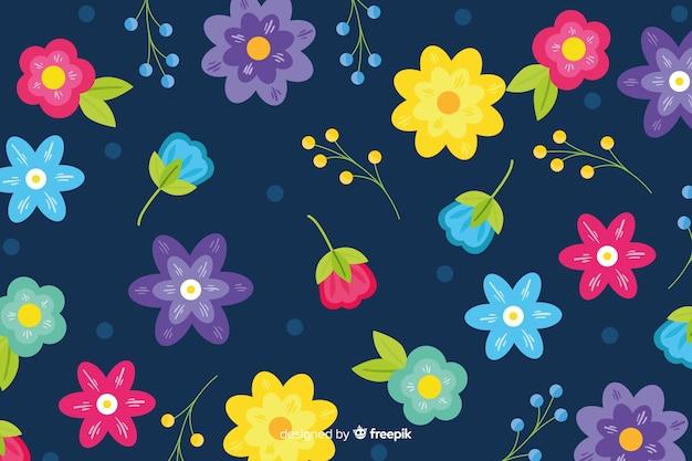 Disegnati a mano bellissimo sfondo floreale Vettore gratuito