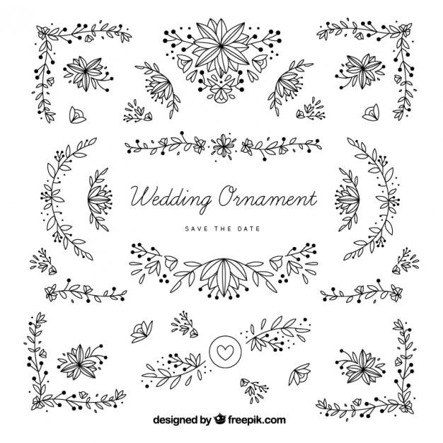 Disegnati a mano ornamenti di nozze con foglie Vettore gratuito