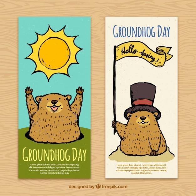 Disegnati a mano striscioni groundhog day Vettore gratuito